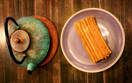 honey cake: Photo of delicious big honey cake and tea in the cafe