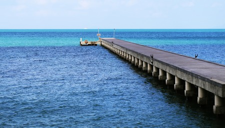 Photos background bright blue seascape with pier Stock Photo