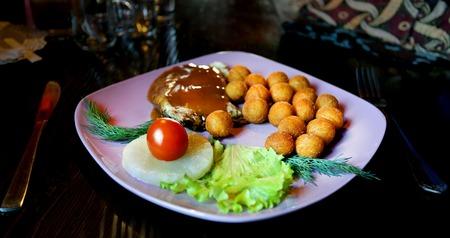 Photo dish of potatoes and chicken Stock Photo