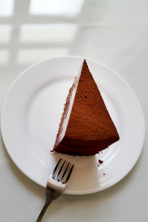 Photo of a sweet truffle cake in a cafe