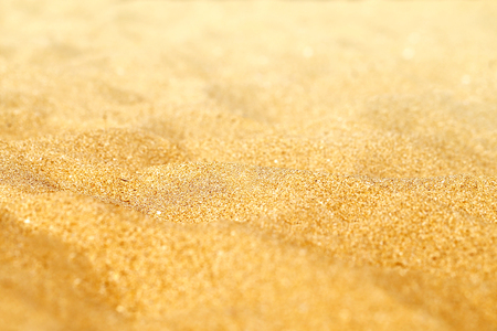 Beautiful texture of yellow sand photographed in close-up Stock Photo