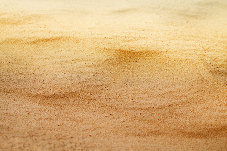 Photo background of a bright color golden sand of a dune