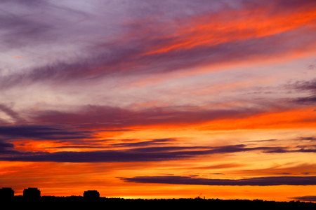 Photo of a brightly beautiful sunset with clouds Stock fotó