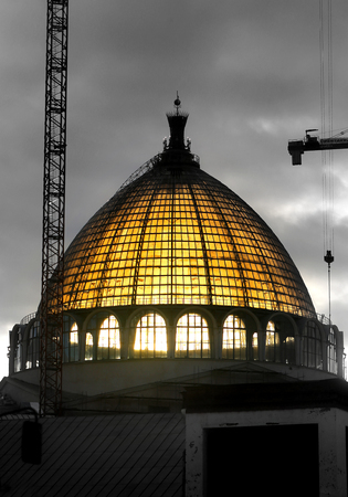 Beautiful photo of the Soviet dome of the pavilion illuminated by the sun