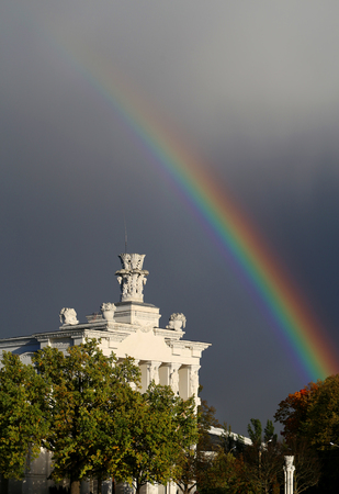 Beautiful photo of the Soviet pavilion and rainbow on a cloudy day in Moscow