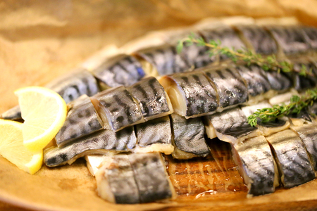 Photo of a delicious sliced herring with lemon on the table