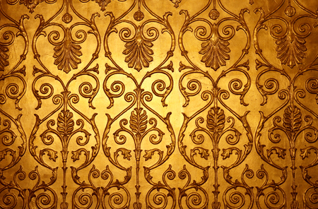 Photo bright golden ornamental wall background