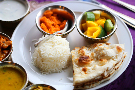 Macro photo of delicious Indian vegetable dishes with curry in a restaurant
