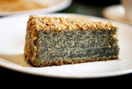 Photo of a macro delicious poppy cake slice in a restaurant