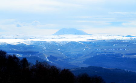 Photo view of Mount Elbrus from the top of the mountains in the sunny day