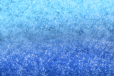 Photo of a background of blue melting snow Reklamní fotografie