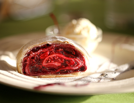 Photo of a macro of delicious bright strudel with cherry and ice cream Stok Fotoğraf