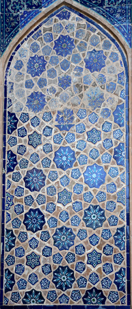 Photo background of gorgeous macro Uzbek oriental ornament on the wall Banco de Imagens - 100636024
