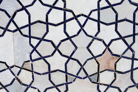 Photo background of gorgeous macro Uzbek oriental ornament on the wall