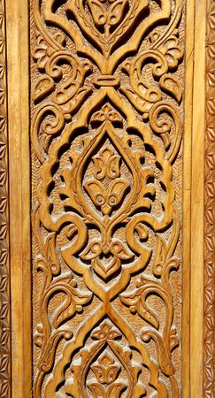 Background about oriental asian wooden ornament on the door Standard-Bild - 100666459