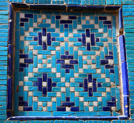 Photo background of gorgeous macro Uzbek oriental ornament on the wall
