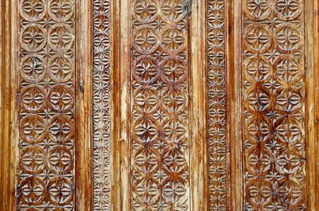 Photo beautiful natural wooden Oriental ornaments on the walls Standard-Bild