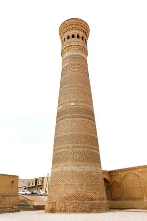 Photo of an ancient beautiful Oriental minaret in Uzbekistan Standard-Bild
