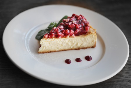 Macro photo of bright delicious cheesecake dessert with fruit in a restaurant