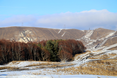 Unusual photo of a gorgeous mountain landscape in early spring