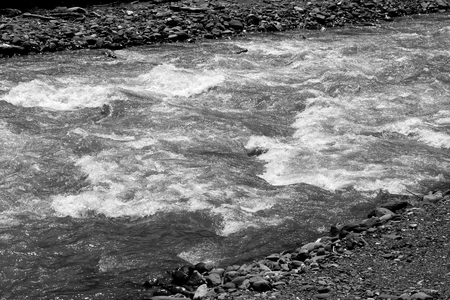 Photo background of bright bubbling water in a mountain river Stock Photo