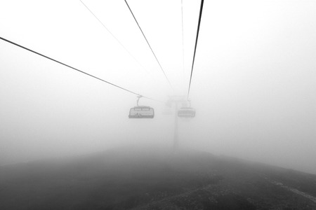 Photo booths on a cable car among mountains in the clouds