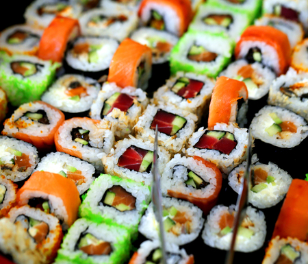 Photo of a macro background of delicious sushi in a restaurant Фото со стока