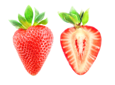 Photo of a macro of a tasty red strawberry and a cut of strawberries on a white background Foto de archivo - 104960794