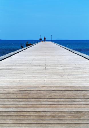 Photo of a tropics bridge pier on a blue sea on a sunny day