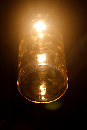 Photo of a bright macro glass lamp in a cafe