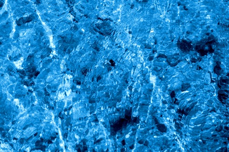 Photo of a macro background of blue sea waves Stock Photo