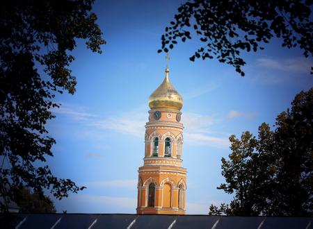 Photo of the Orthodox bell tower illuminated