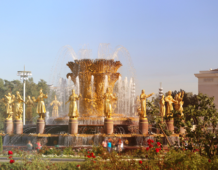 Photo of a macro golden fountain Friendship of peoples in Moscow park