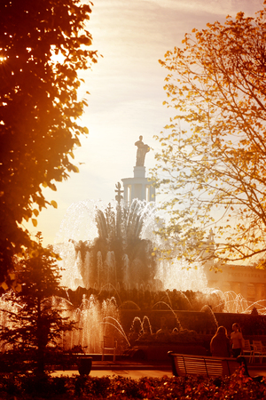 Photo of a beautiful macro fountain in Moscow in the park is illuminated by the sun