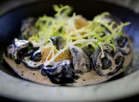 Photo of macro delicious dumplings with pike caviar and salad