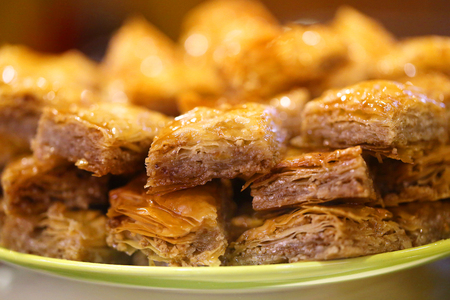 Macro photo of delicious bright Turkish baklava with honey in a restaurant Stok Fotoğraf