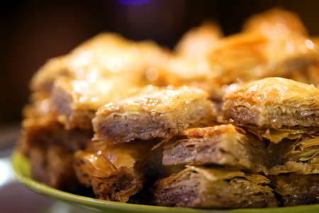 Macro photo of delicious bright Turkish baklava with honey in a restaurant Imagens