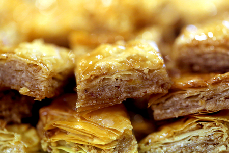 Macro photo of delicious bright Turkish baklava with honey in a restaurant Stock fotó