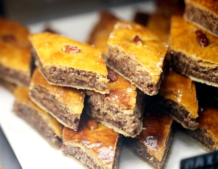 Photo of bright tasty sweet baklava with nuts in the store Stok Fotoğraf