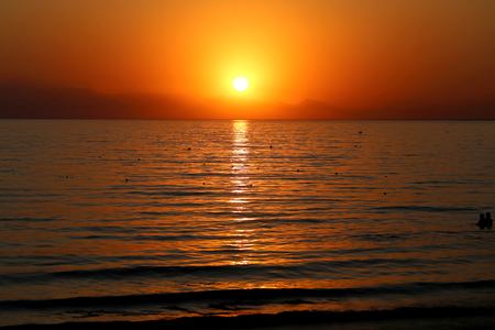 Photo background bright unusual sunset on the sea in the evening Stock Photo