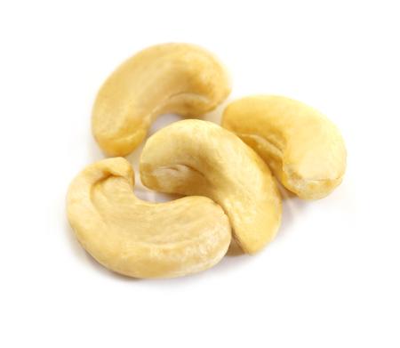 Photo macro of large isolated cashew nuts on a white background 스톡 콘텐츠
