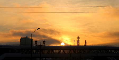 Bright photo background sunset sky in the city in the evening Фото со стока
