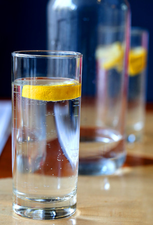Photo of macro clear water with lemon in a glass glass Cup in a restaurant Фото со стока