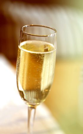 Fine macro photo of champagne glass in a restaurant