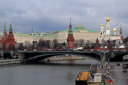 Photo of the beautiful landscape of the Moscow Kremlin with a bridge and a river