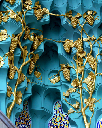 Macro photo of soviet golden decorative ornament on blue background 写真素材