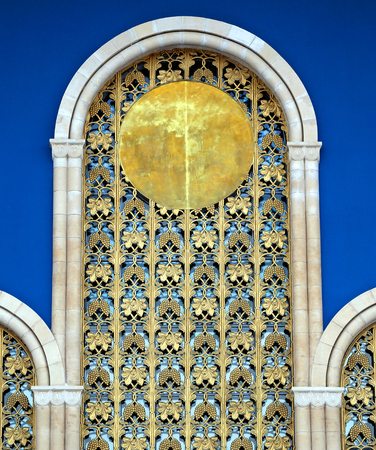 Macro photo of soviet golden decorative ornament on blue background Zdjęcie Seryjne