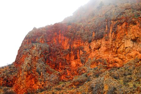 Photo of beautiful fiery red mountains and rocks