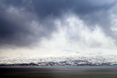 Photo background mountain landscape on a cloudy snowy day in Armenia on Sevan