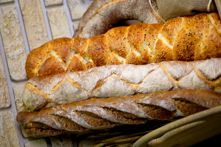 Macro photo of big tasty fresh bread in a cafe